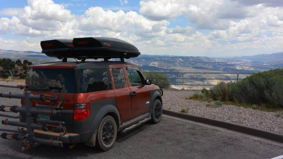 Red Honda Element Scenic Lookout Black Wheels Nerf Bars Roof Rack Yakima Roof Basket Travel Luggage Box Travel Hitch Mount Bike Rack