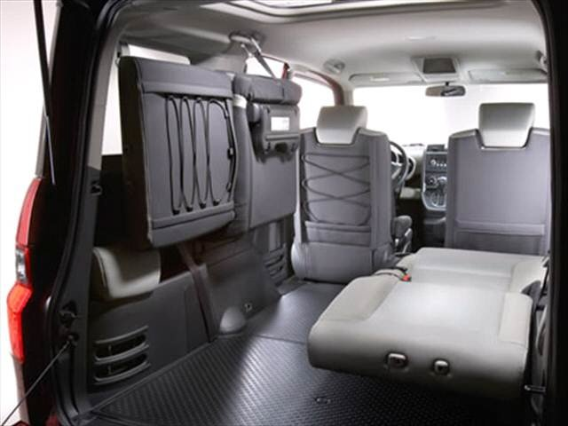 honda element interior configuration rear passneger seat folded laying back while backseat drivers side is mounted up against the wall