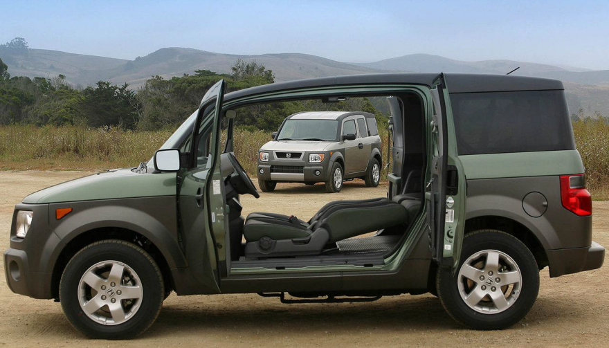 honda element interior configuration suicie door wide open with both front seats folded back all the way